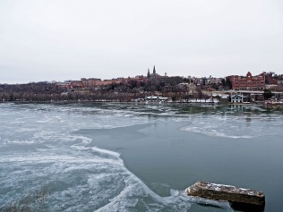 Ice on the Potomac River. Healy Hall marks Geogetown University on the skyline at center.