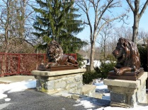 Two lions, nicknamed Leo and Theo, guard the walkway to the Kappa Delta Pi Windmill