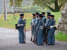 Soldiers in period uniforms formed up near the Arsenal